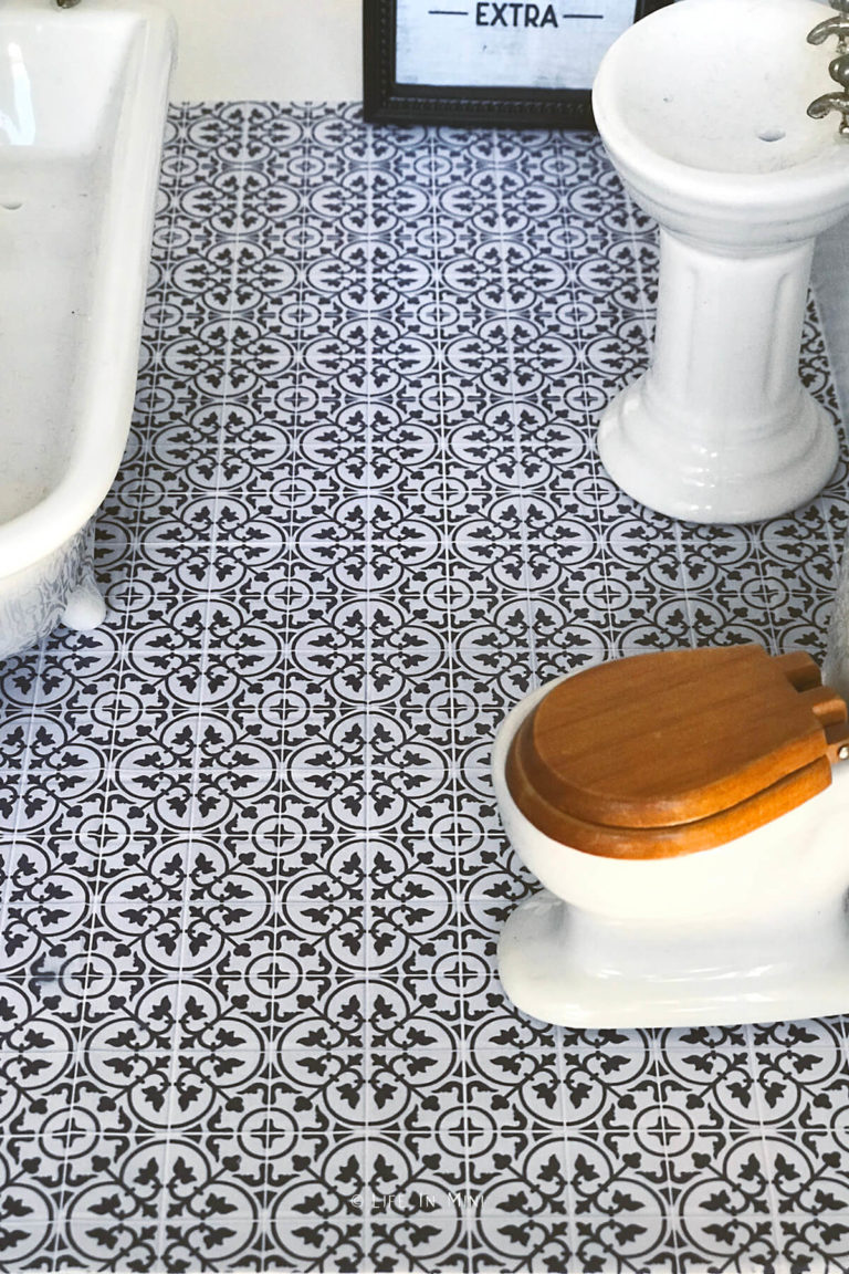 Closeup of miniature bathroom tile made with photo paper