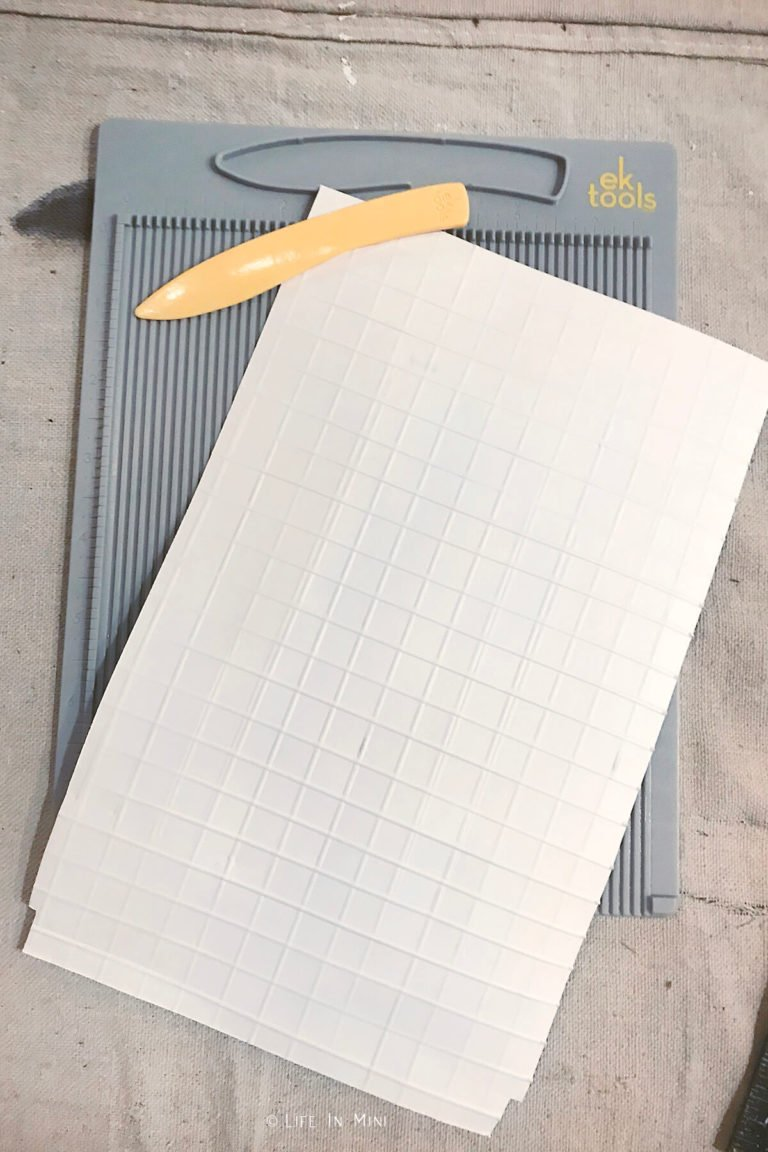 Scoring photo paper to mimic grout lines for dollhouse bathroom flooring