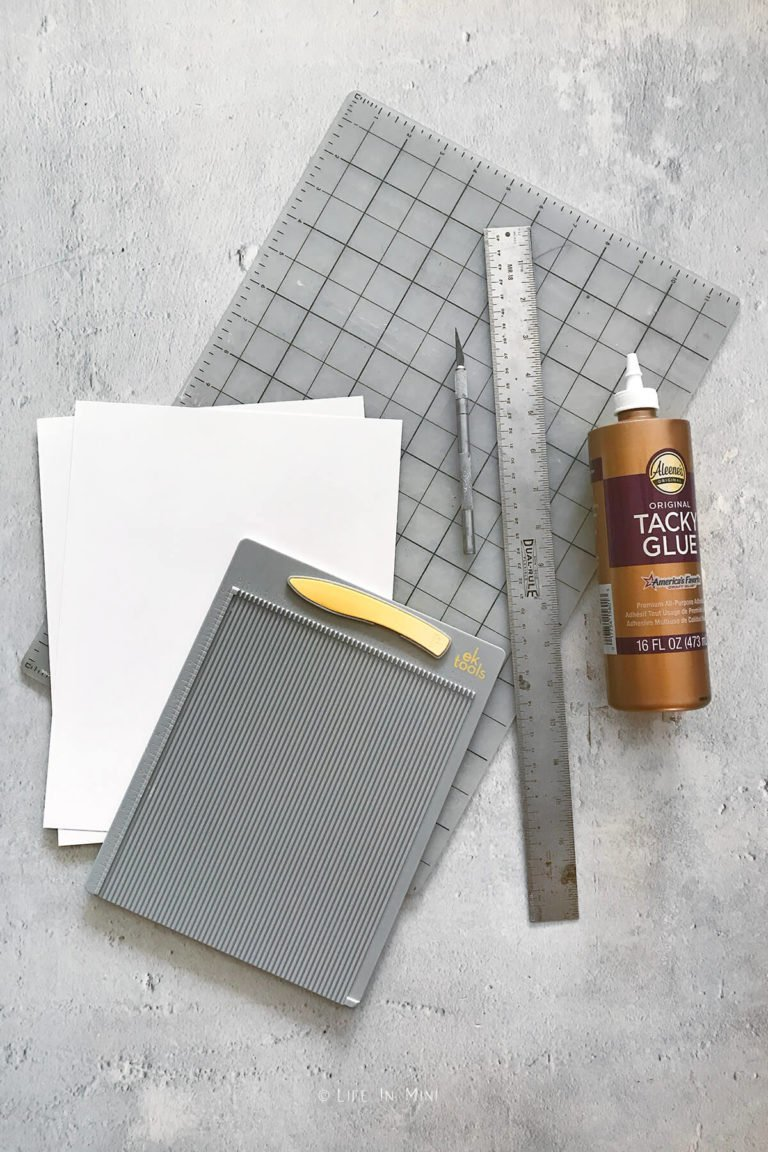 Supplies needed to make miniature dollhouse tile using photo paper