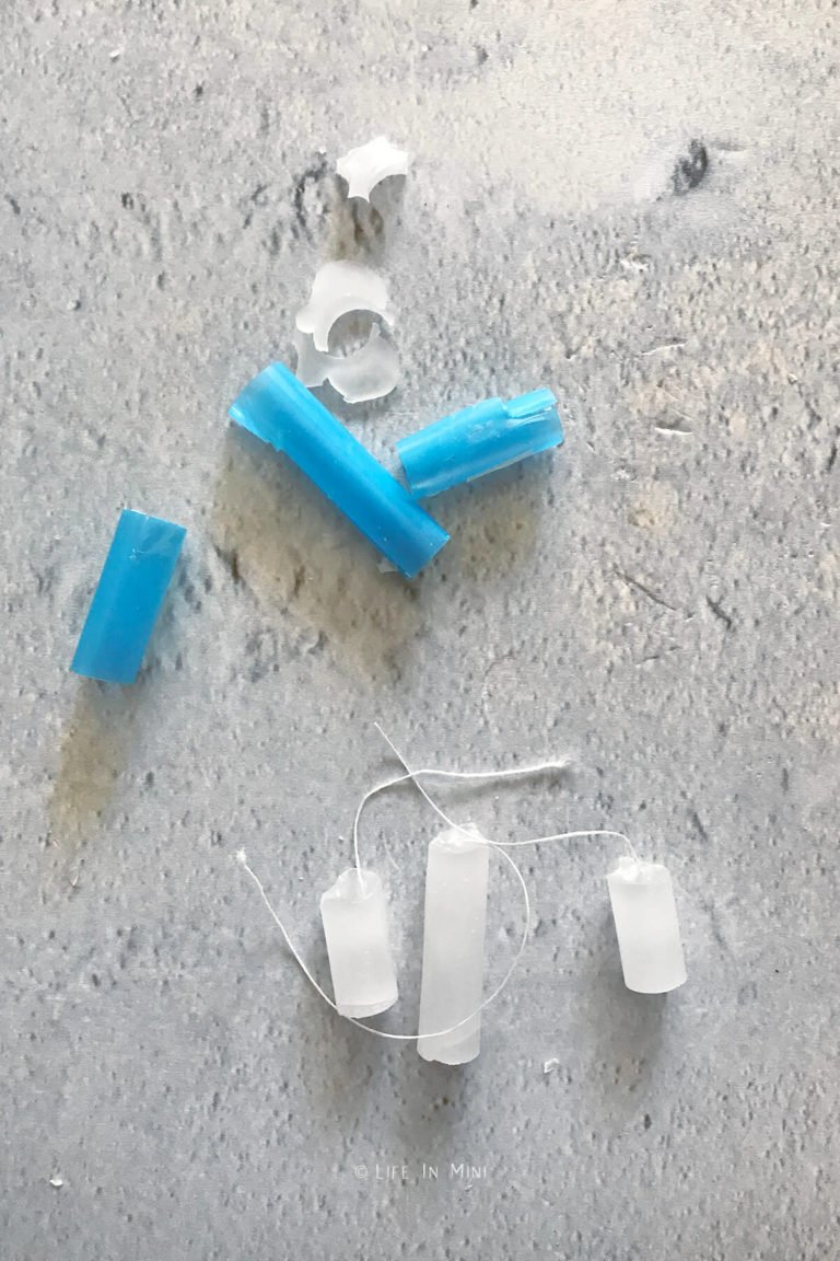 Miniature candles cut out of plastic straw molds