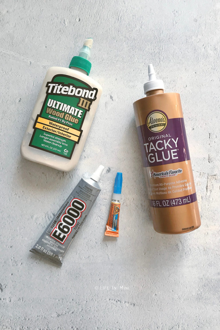 Assortment of glues used in building miniatures and dollhouse accessories