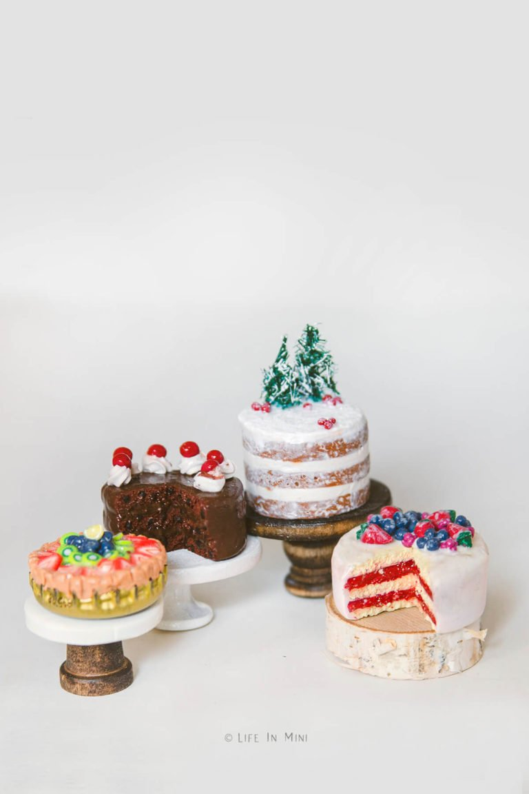 Assorted miniature cakes on assorted miniature cake stands