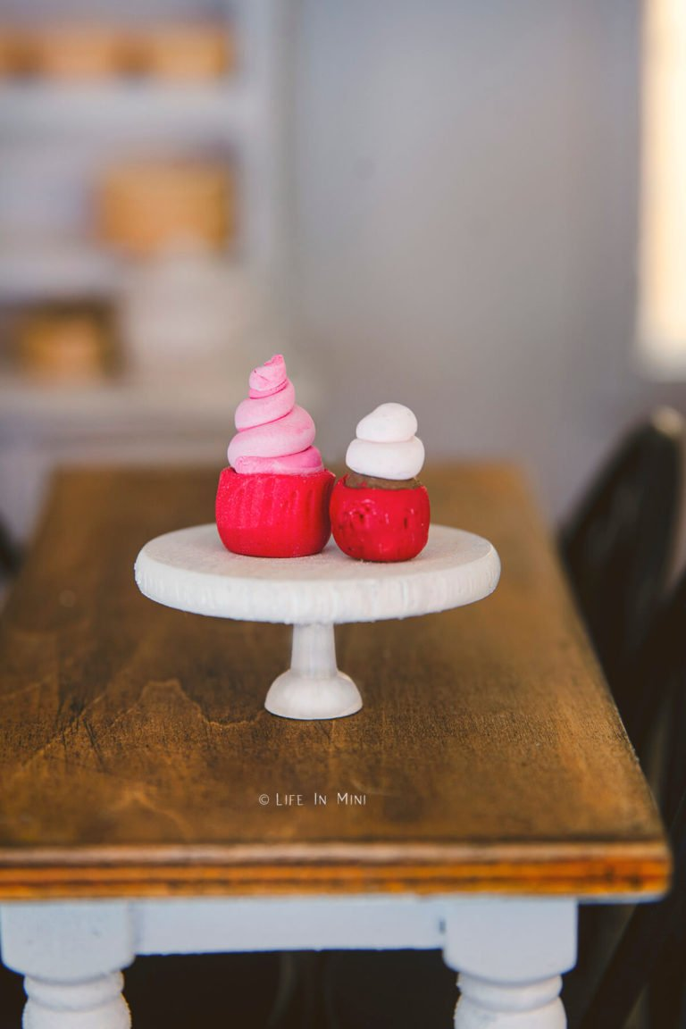 Miniature cupcakes on a white cake stand