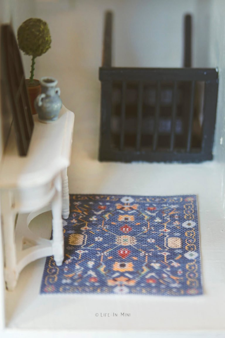 Dollhouse hallway with a small console table and blue rug