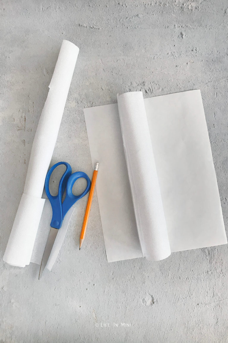 Cutting embroidery fabric to fit onto freezer paper