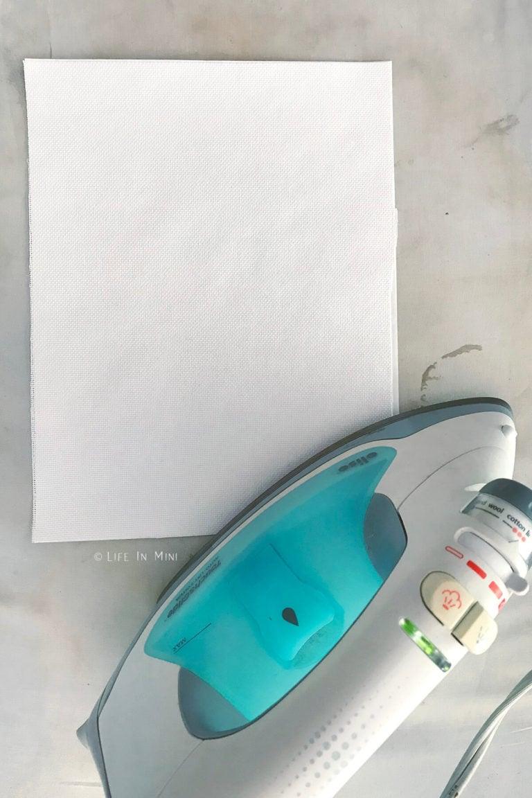 Ironing embroidery fabric onto freezer paper