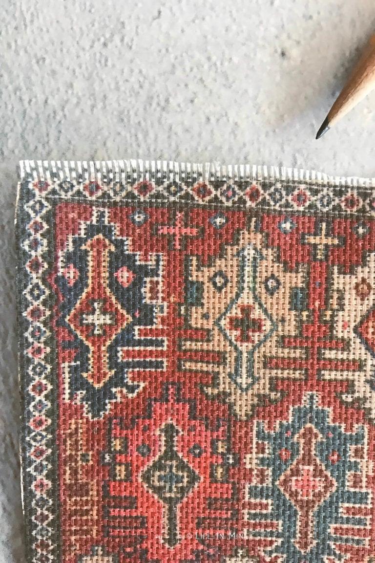 Closeup details of miniature dollhouse rug