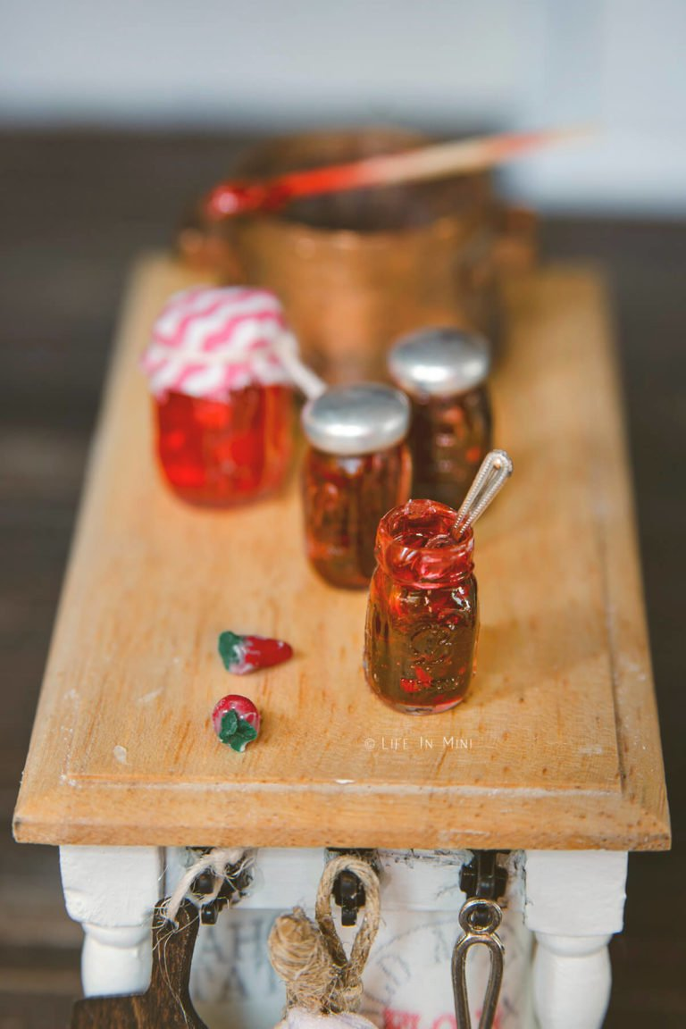 Closeup of several mini jars with strawberry jam made from uv resin