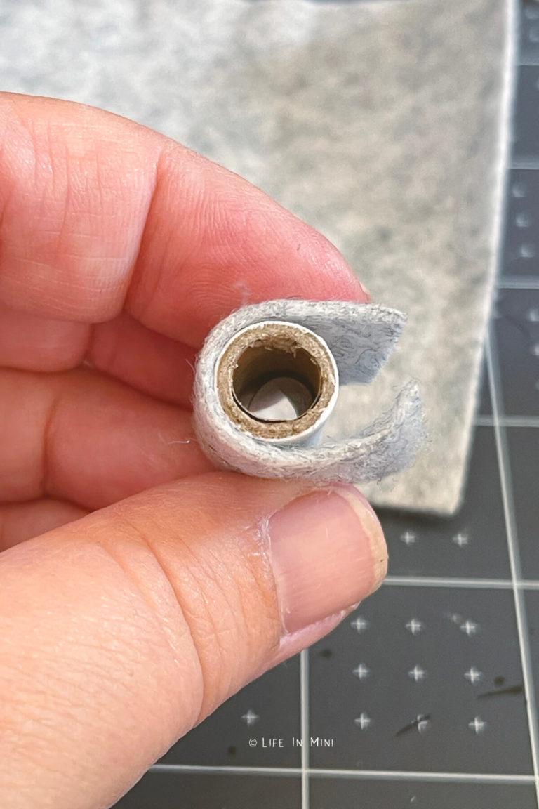 Gluing felt on a cardboard tube