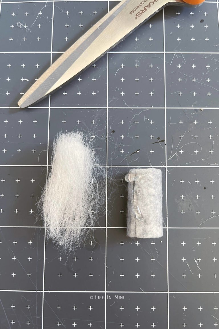 Cutting white felting wool for a beard for miniature gnome