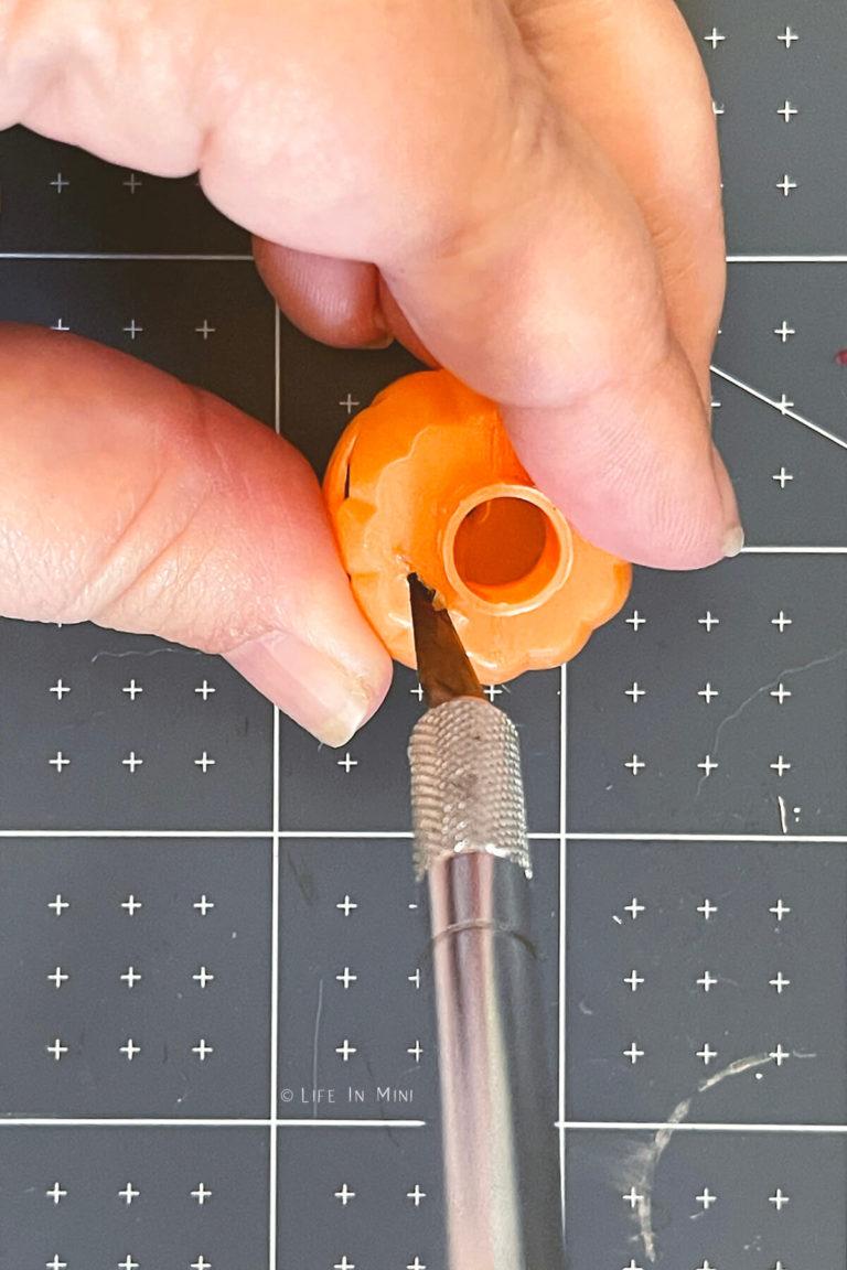 Cutting top off plastic mini pumpkins